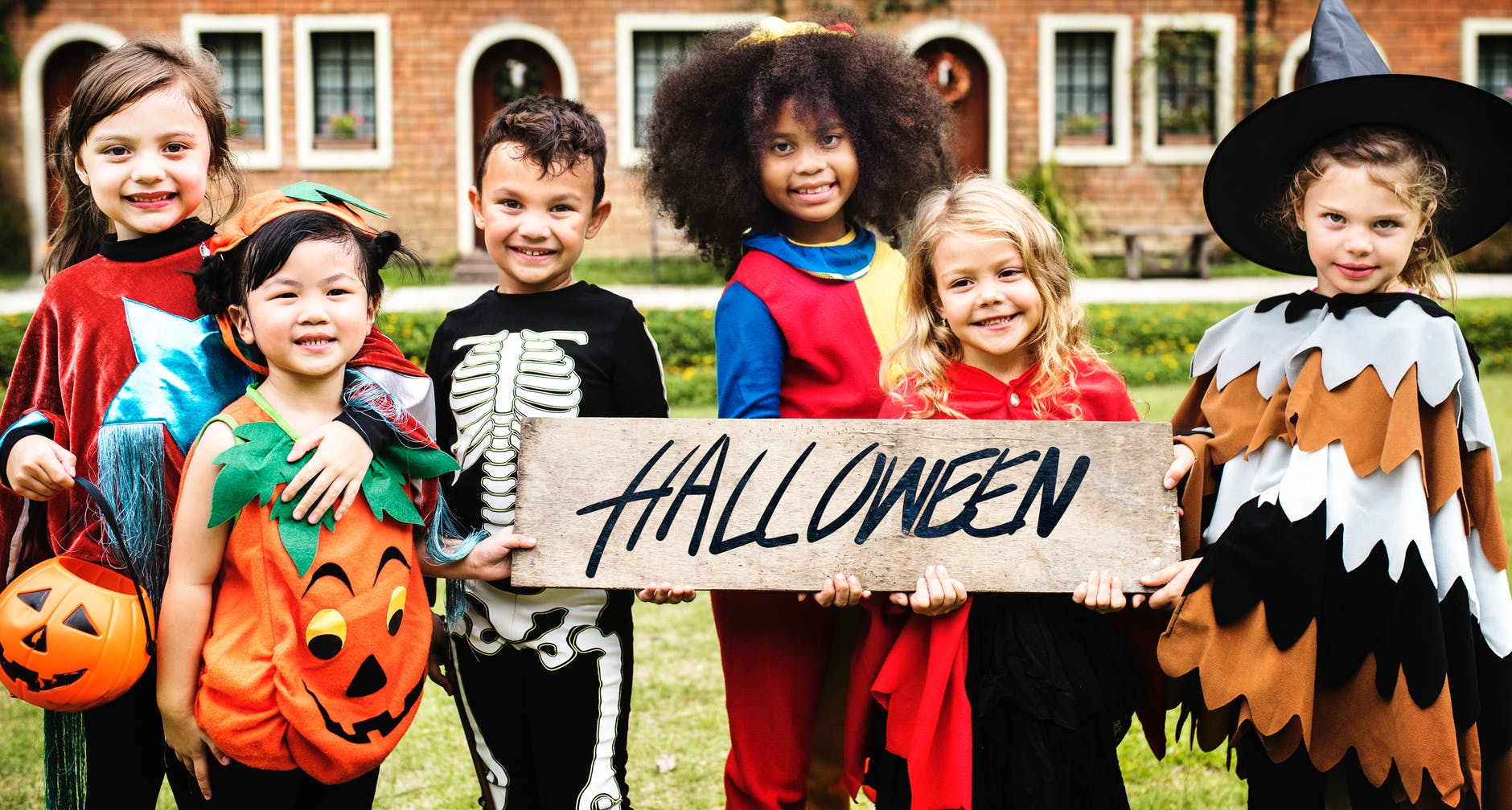 photo of children in halloween costumes smiling